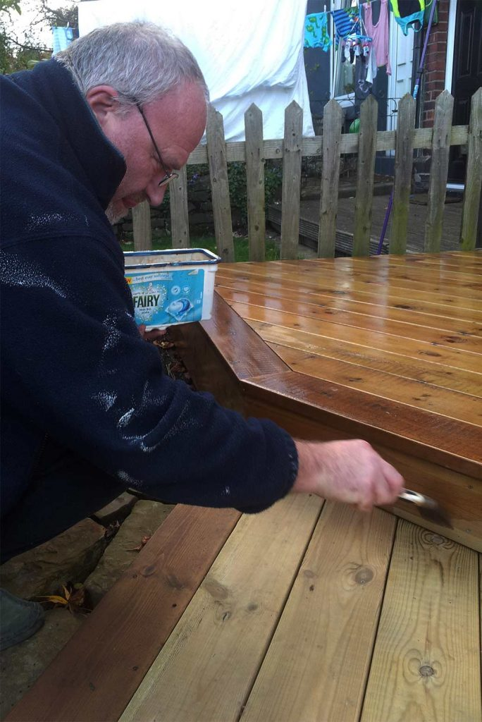 Oiling the deck with a light oak stain