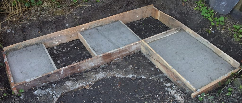 Concrete footings including shuttering